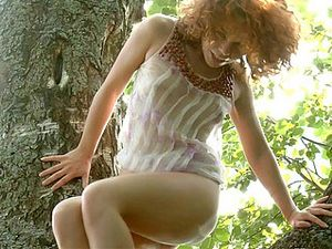 Redhead In A Tree Has A Wonderful Wet Pussy